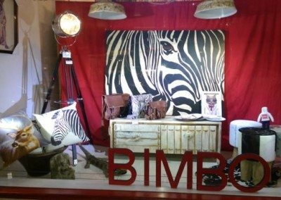 Bimbo front window featuring jungle them gifts handbags and prints