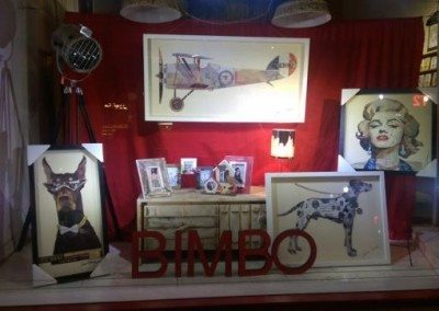 Bimbo front window featuring large collage wall prints